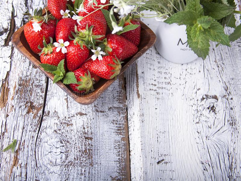 Summer berries on a wooden background royalty free stock images