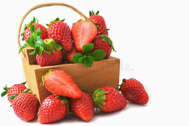 Strawberries on a wooden box on an isolated white background stock photo