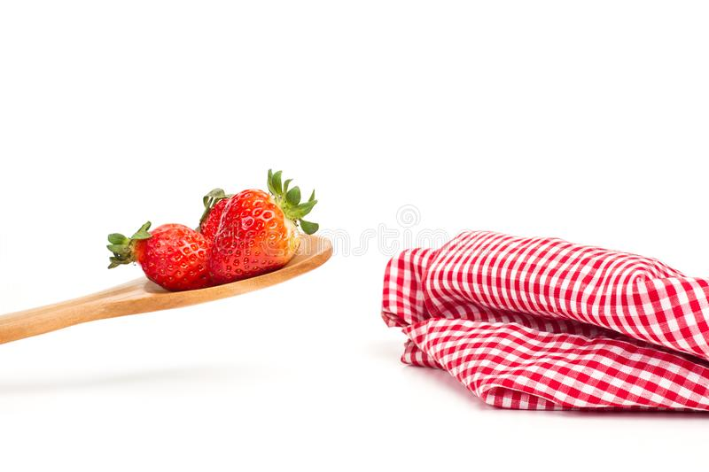 Strawberries on a wooden spoon stock images