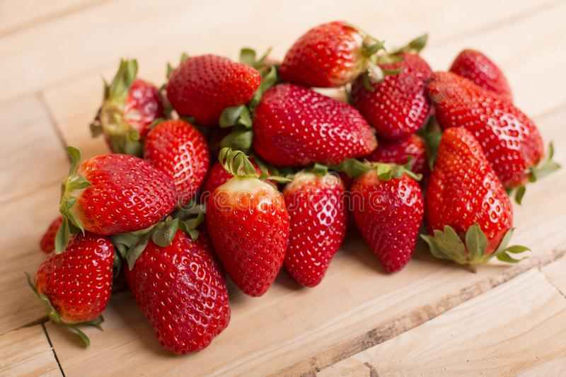 Strawberries. On a wooden table, studio picture royalty free stock photo