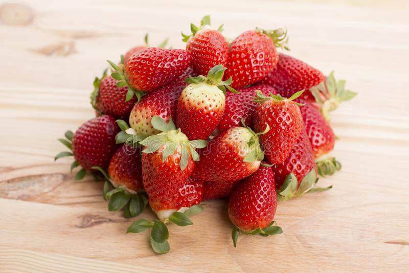Strawberries. On a wooden table, studio picture royalty free stock image