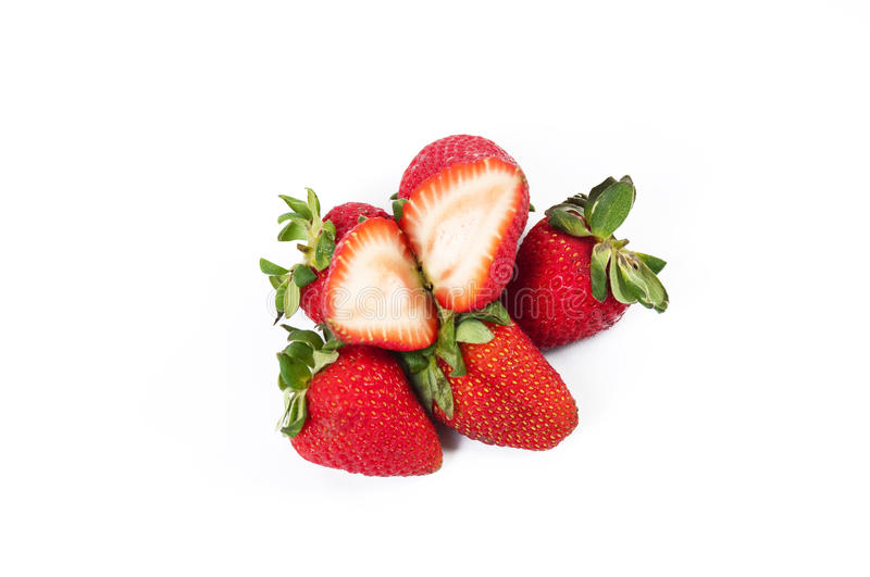 Strawberry. A strawberry and cut strawberries royalty free stock image