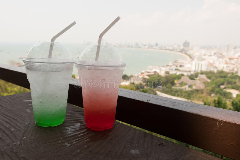 Strawberry ade and apple ade with soda is the perfect refreshing summer drink. Ice strawberry ade and green apple ade with soda is the perfect refreshing summer stock image
