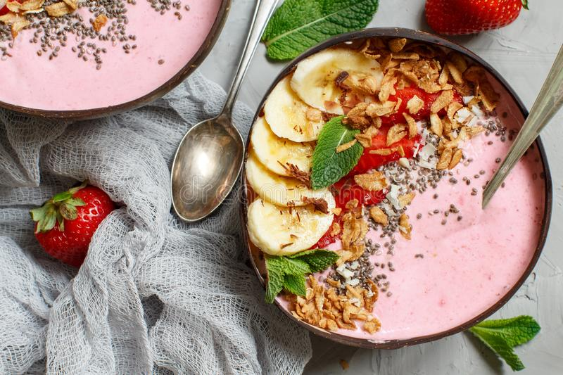 Strawberry and banana smoothie bowls stock photo