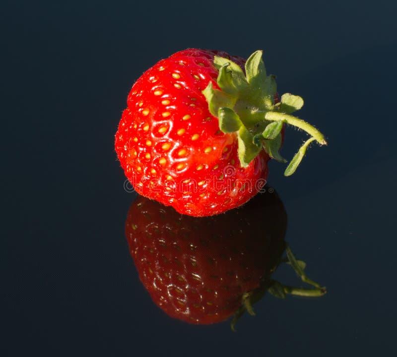 Strawberry on black glass 3. Double strawberry on black glass 3 stock photos