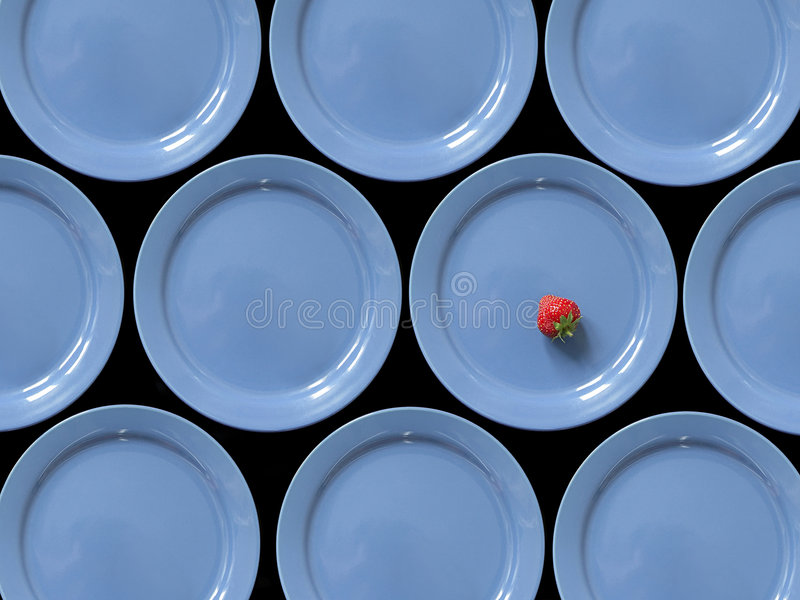 Strawberry and blue plates royalty free stock images