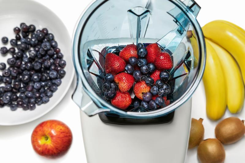 Series of shots. Photo 6. Strawberries and blueberries in a blender. Series of shots. Photo 6. Blender in a top view, with ingredients for a smoothie. In this stock image