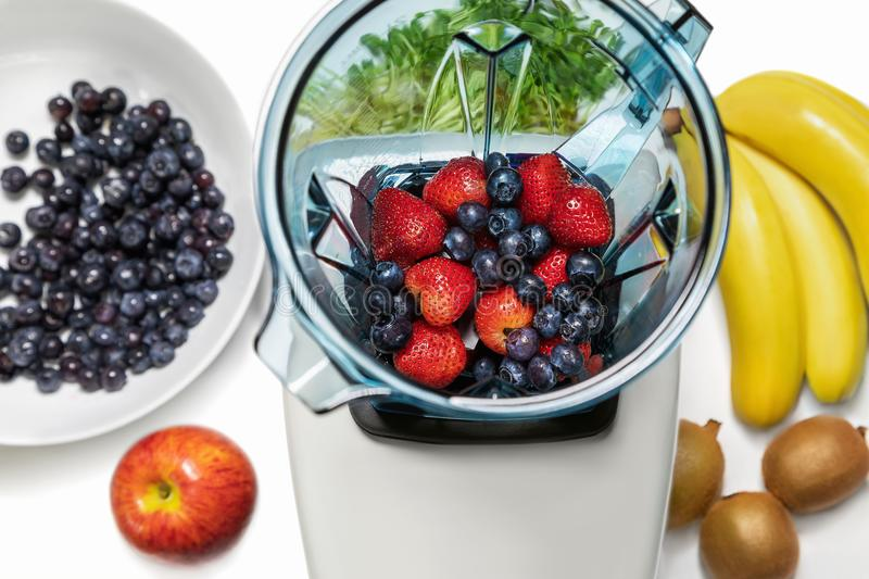 Series of shots. Photo 7. Strawberries and blueberries in a blender. Series of shots. Photo 7. Blender in a top view, with ingredients for a smoothie. In this royalty free stock image