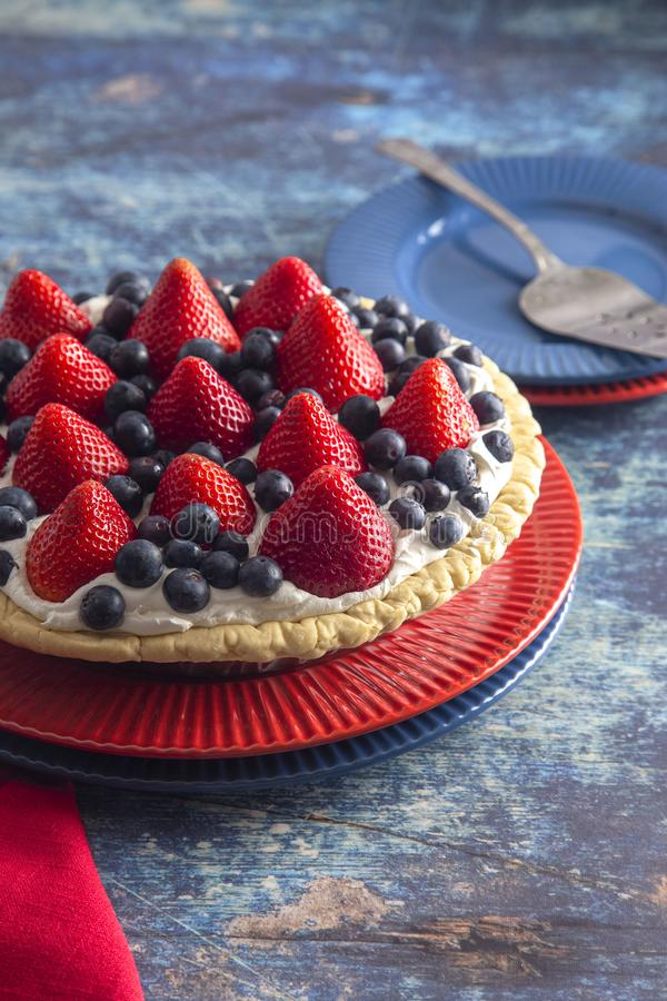A Strawberry and Blueberry Fresh Summer Pie on a Distressed Blue Wooden Table. Strawberry and Blueberry Fresh Summer Pie on a Distressed Blue Wooden Table royalty free stock images