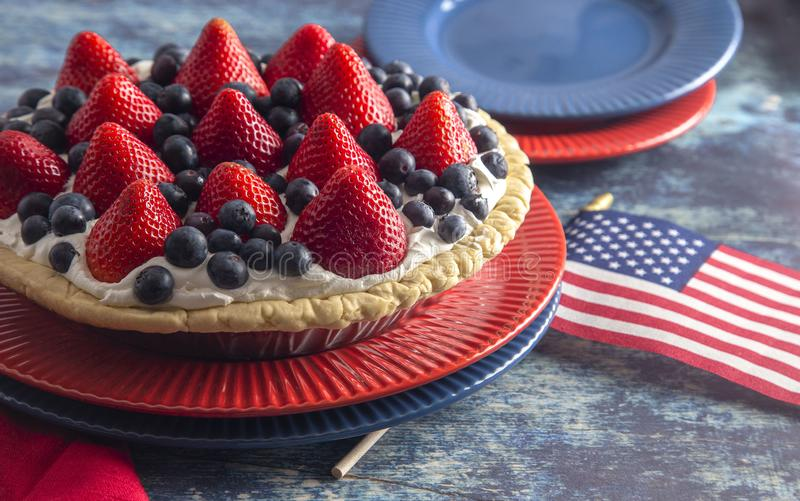 A Strawberry and Blueberry Fresh Summer Pie on a Distressed Blue Wooden Table. Strawberry and Blueberry Fresh Summer Pie on a Distressed Blue Wooden Table royalty free stock photos