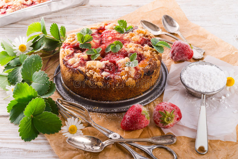 Strawberry buttermilk cake with pistachios stock photography