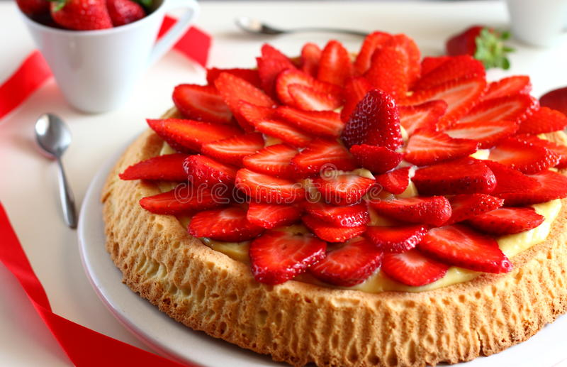 Strawberry cake. With delicious vanilla cream stock photo