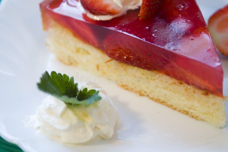 Strawberry cake. Slice of strawberry shortcake with whipped cream royalty free stock photos
