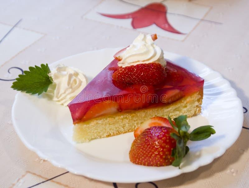 Strawberry cake. Slice of strawberry shortcake with whipped cream stock photos