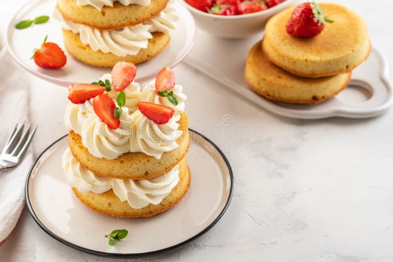 Strawberry cake with vanilla cream on white background. Copy space. stock photo