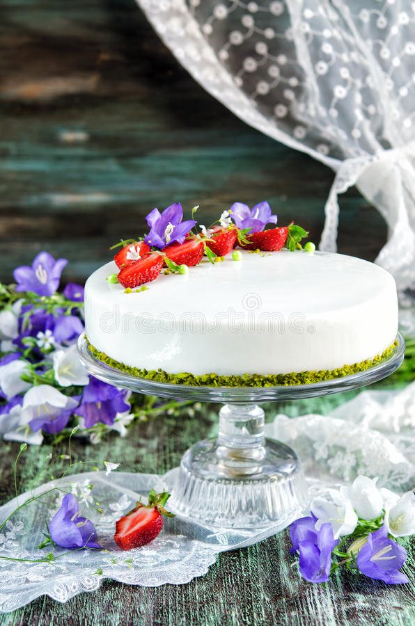 Strawberry cake with vanilla mousse. Under the mirror glaze royalty free stock images