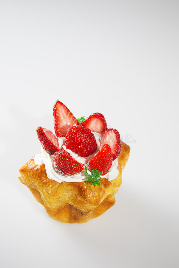 Strawberry cake on white background with vertical shoot stock photos