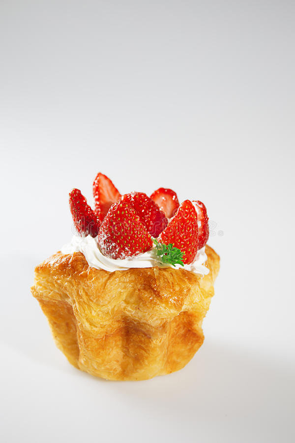 Strawberry cake on white background with vertical shoot stock image