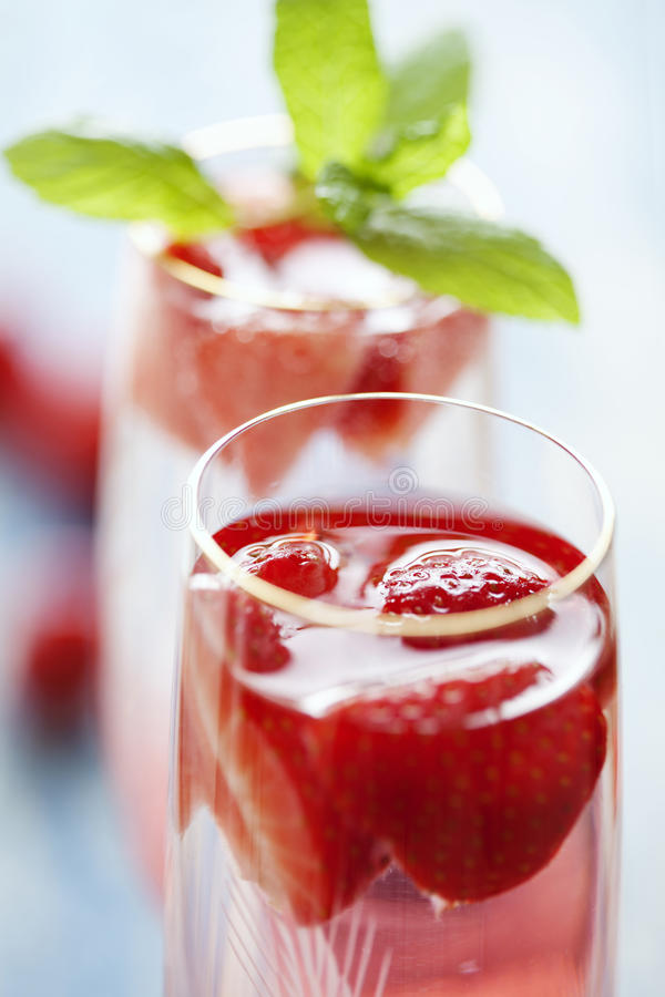 Strawberry champagne cocktail stock photo