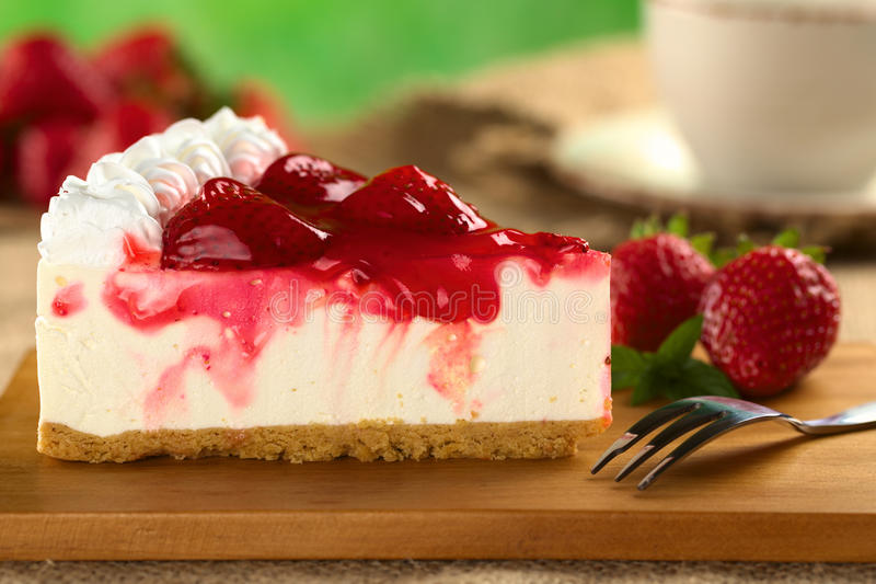 Strawberry Cheesecake. Fresh strawberry cheesecake (Selective Focus, Focus on the front upper edge of the cake stock images
