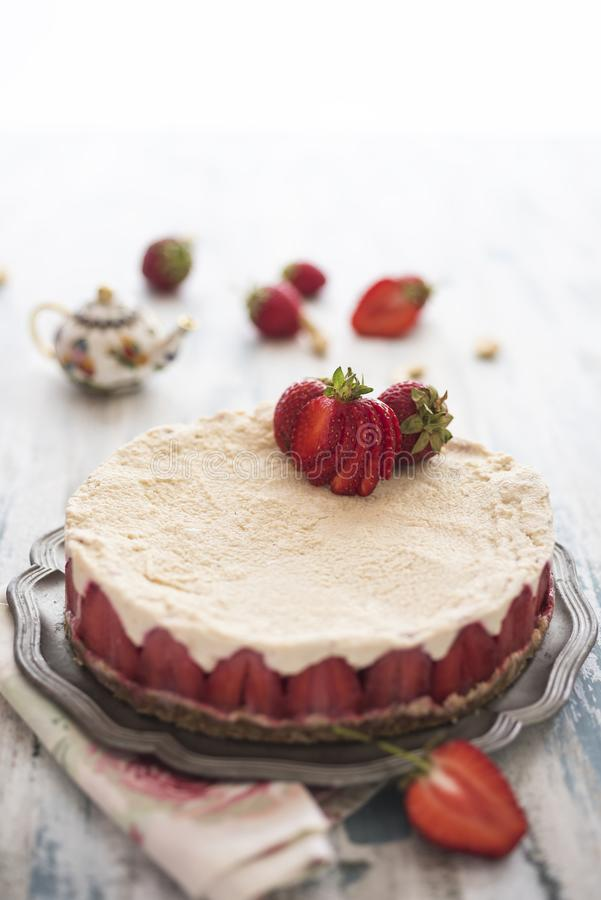 Strawberry cheesecake with fresh fruits royalty free stock images