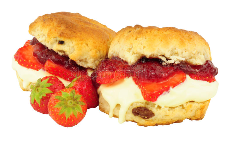 Strawberry And Clotted Cream Filled Scones. Fresh Strawberry and clotted cream scones with strawberry jam isolated on a white background stock image