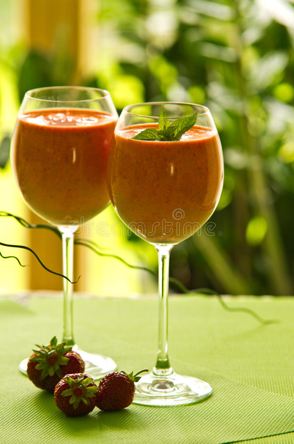Strawberry cocktail in glasses royalty free stock image