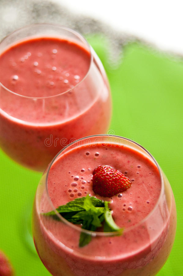Strawberry cocktail in glasses stock photo