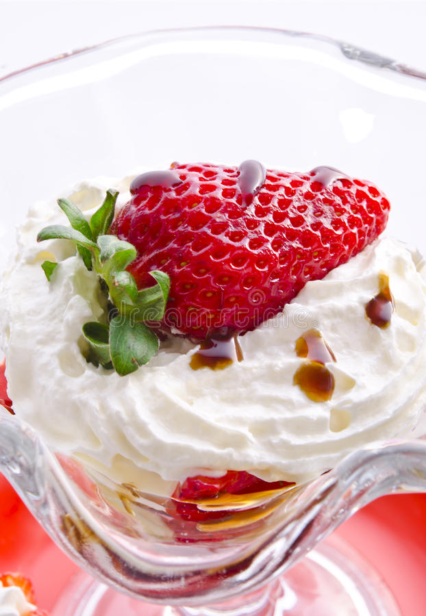 Strawberry with cream. A fresh strawberry with cream stock photography