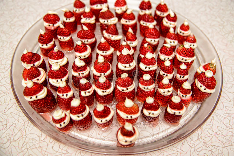 Strawberry and Cream Santa Clause Treats. A glass plate with Strawberry and Cream Santa Clause Treats on counter top stock image