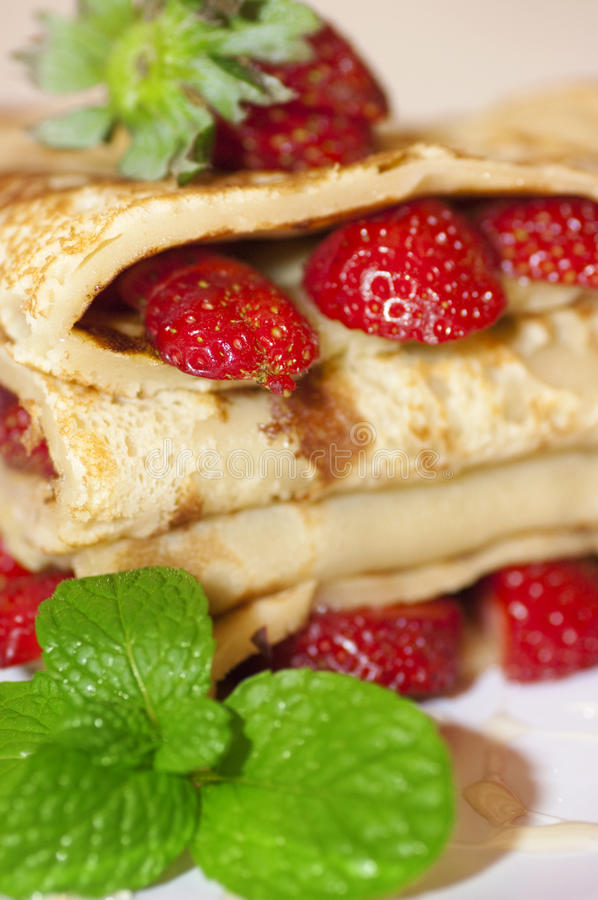 Strawberry crepe. Close up delicious strawberry crepe royalty free stock image