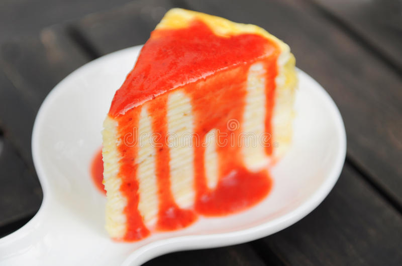Strawberry crepe cake. A piece of strawberry crepe cake royalty free stock images