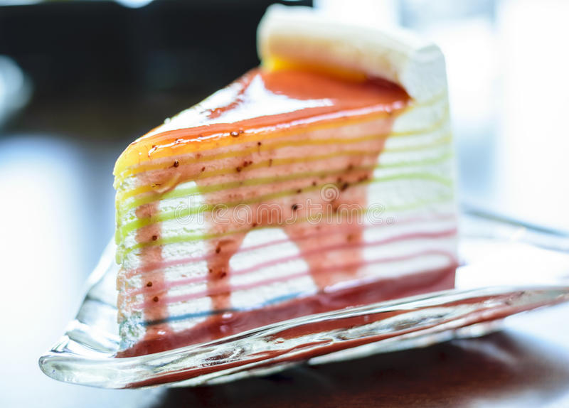 Strawberry crepe cake on glass dish stock photography