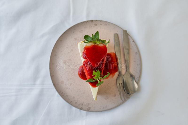 Strawberry crepe cake with strawberry sauce stock image