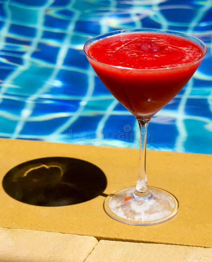 Strawberry Daiquiri cocktail. And swimming pool stock images