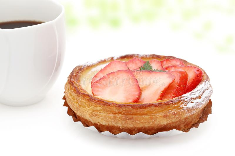 Strawberry danish bread. And cup of coffee for breakfast stock images