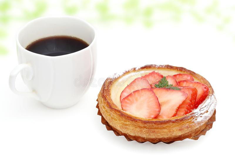 Strawberry danish bread. And cup of coffee for breakfast stock photo
