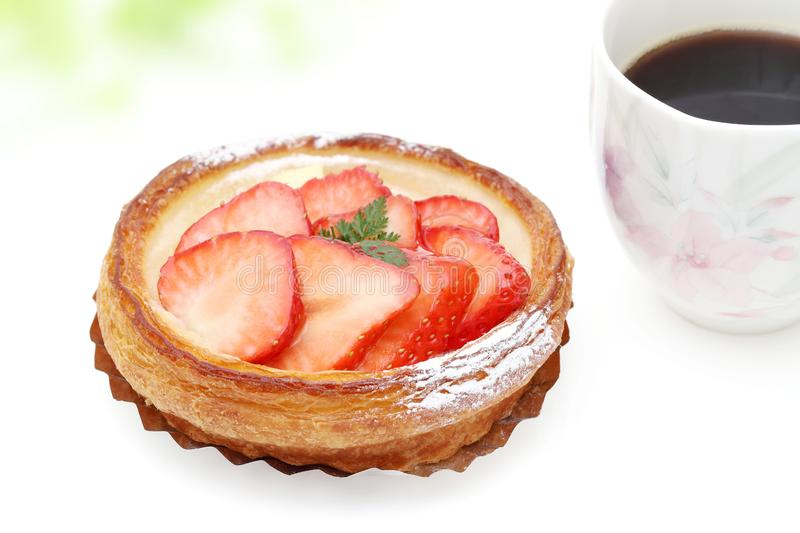 Strawberry danish bread. And cup of coffee for breakfast stock photos