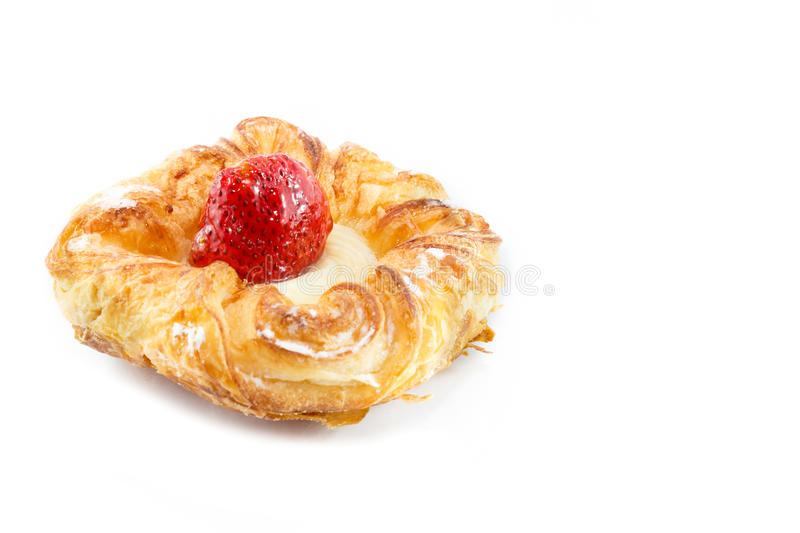 Strawberry denish. Denish pastry with fresh strawberry and crystal sugar royalty free stock image