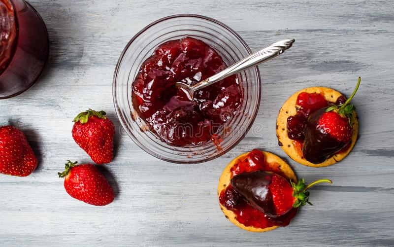 Strawberry dessert on a biscuit with jam royalty free stock photos