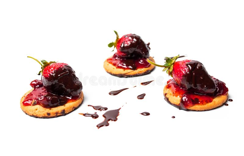 Strawberry dessert on a biscuit with jam stock photography