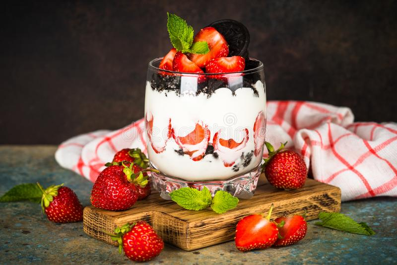 Strawberry dessert parfait with yogurt and chocolate cookies. Strawberry dessert parfait with fresh strawberry, yogurt and chocolate cookies. Healthy snack or royalty free stock photography