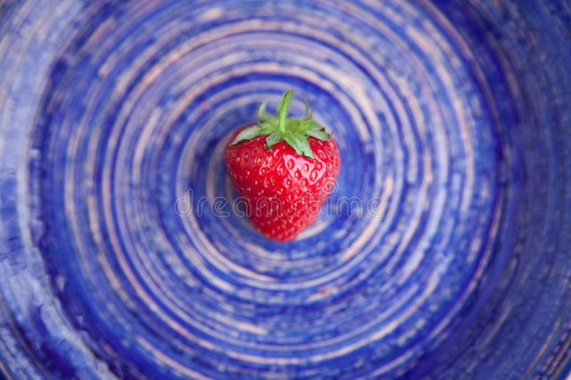 Strawberry on a dish stock image
