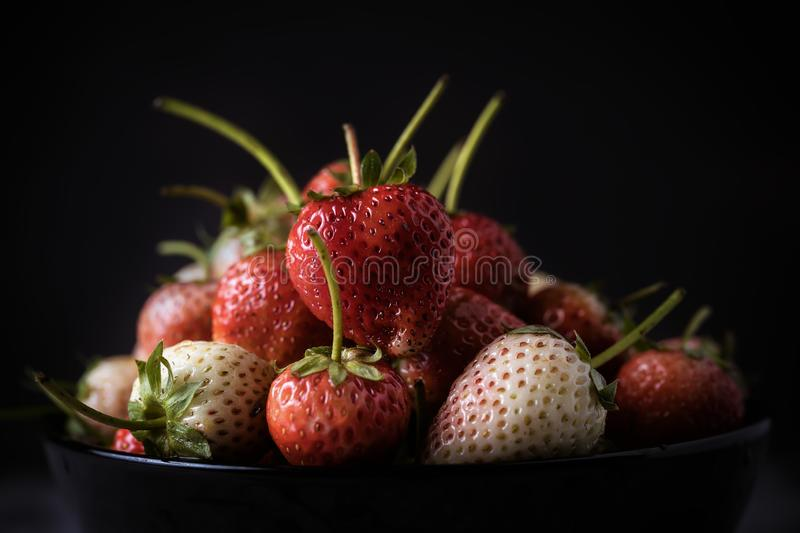 Strawberry fresh berries in a bowl. Of black. Strawberry`s antioxidants royalty free stock photos
