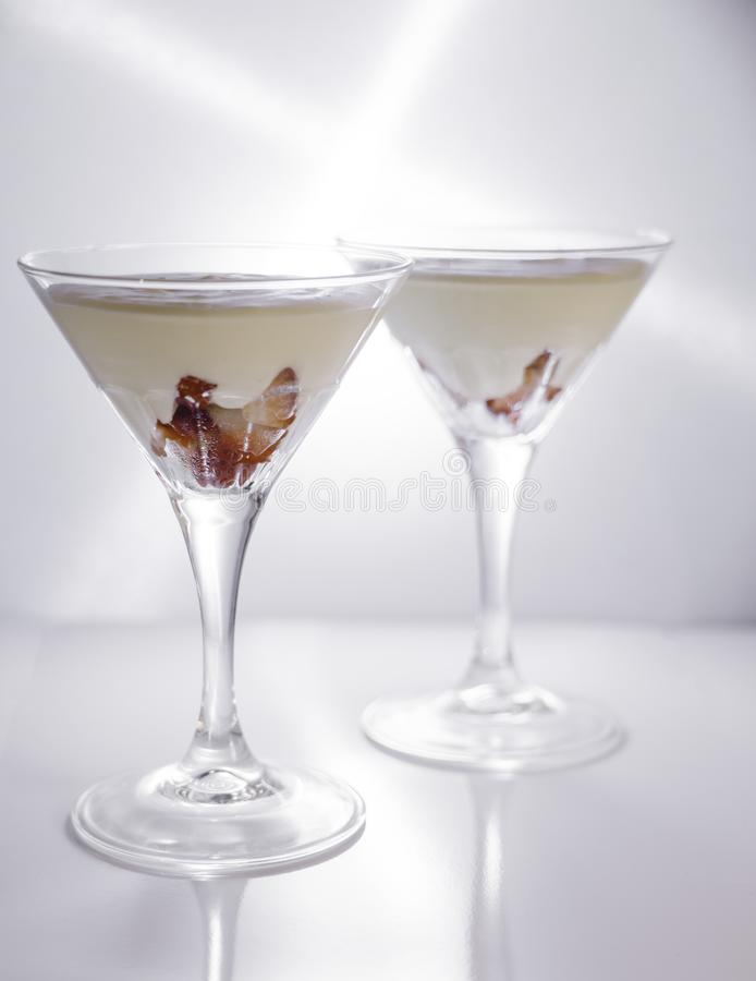 Strawberry fromage dessert. In coctail glasses and lighted with artificial light. Dessert and coctail concept royalty free stock photos