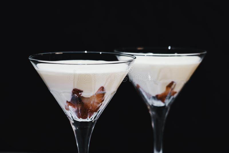 Strawberry fromage dessert. In coctail glasses and lighted with artificial light. Dessert and coctail concept royalty free stock image