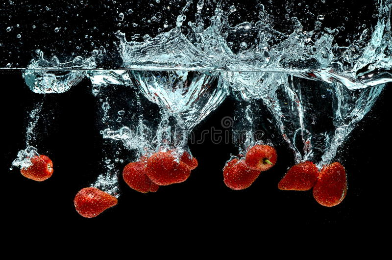 Strawberry Fruit Splash On Water Royalty Free Stock Photography