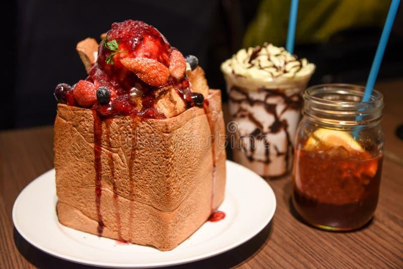 Strawberry honey toast with fruit jar and milk shake stock photo