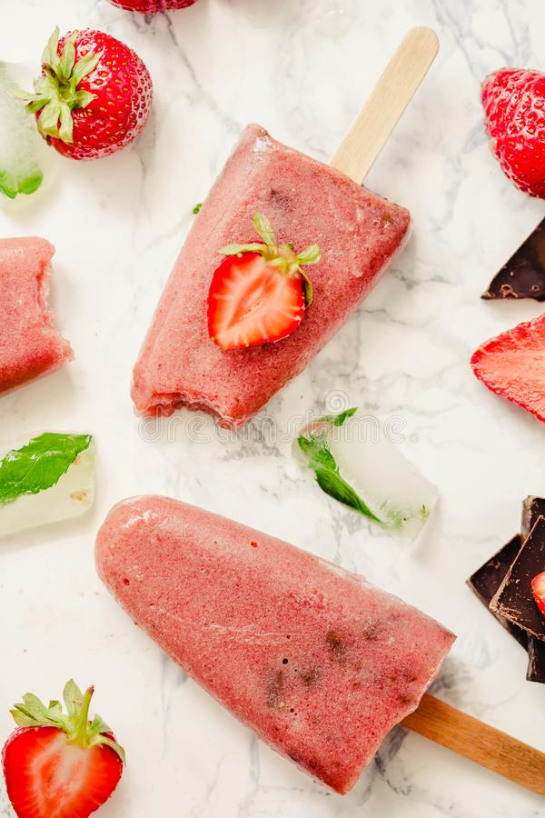 Strawberry ice cream with a banana and chocolate on a stick. Sum stock photo