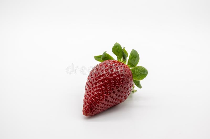 One only red and ripe strawberry stock images